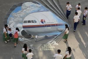 un-dessin-du-vol-mh370-dans-une-ecole-de-manille-philippines-photo-afp-ted-aljibe