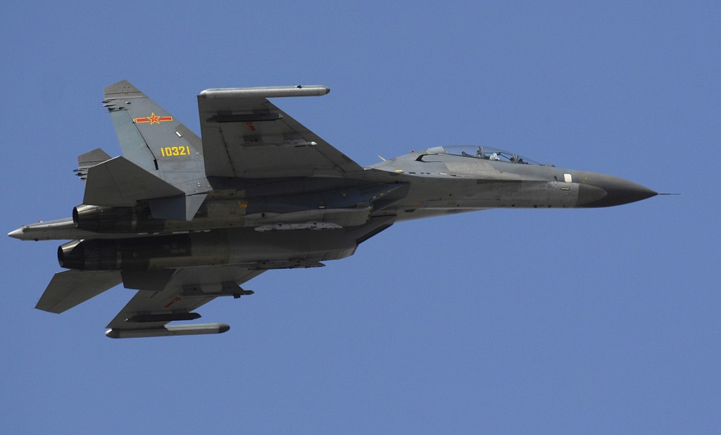 A Chinese Su-27 Flanker fighter makes a fly by while the Chairman of the Joint Chiefs of Staff, Marine Gen. Peter Pace, visits with members of the Chinese Air Force at Anshan Airfield, China Mar. 24, 2007. DoD photo by Staff Sgt. D. Myles Cullen (released)